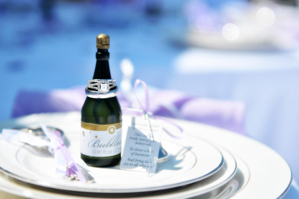 wedding rings on champagne