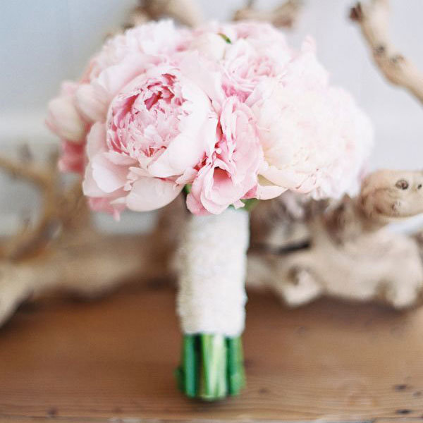 Top 10 flowers for spring weddings bridalguide peony wedding bouquet mightylinksfo