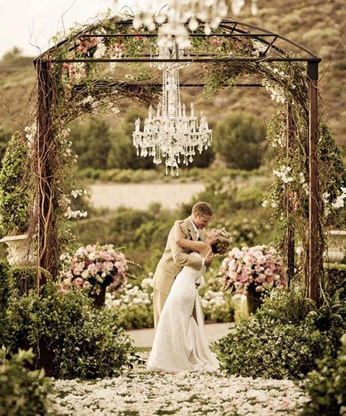 outdoor wedding with a crystal chandelier
