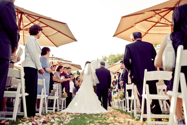 umbrellas at wedding ceremony