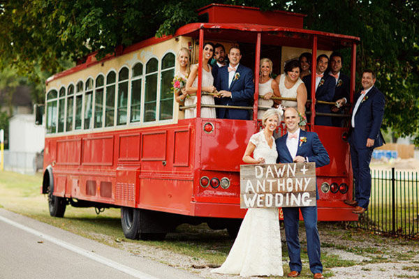 bridal party in a red trolley