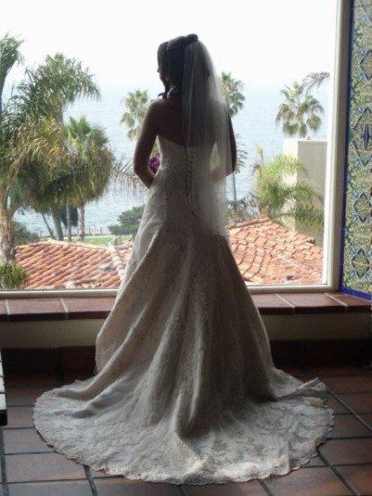 Affordable wedding dresses bridalguide for Pre worn wedding dresses
