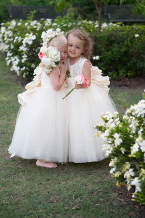 flower girls hugging