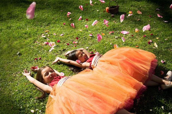 flower girls in the grass