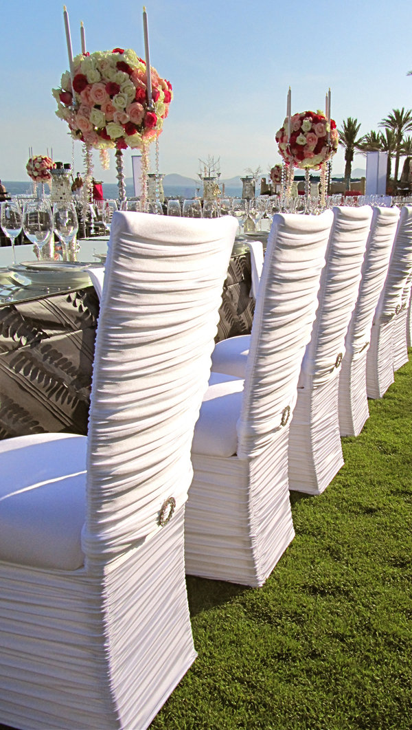 White chair covers work equally well at an outdoor wedding