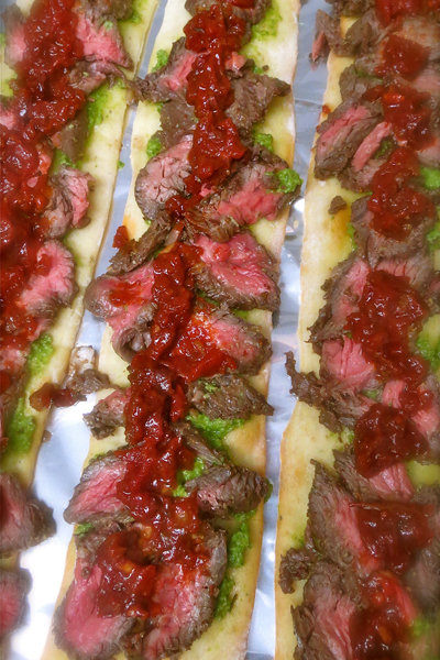 flatbread with steak tomato chutney and kale pesto