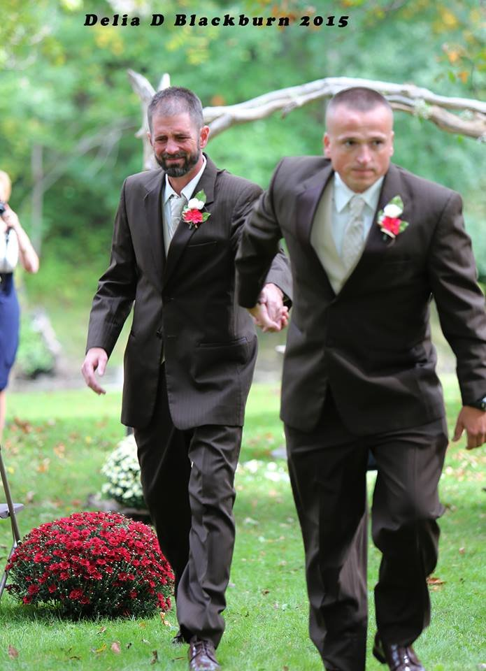 brides father and stepfather walk down the aisle