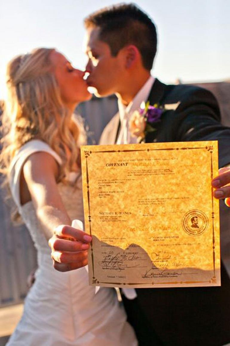 couple holding marriage license
