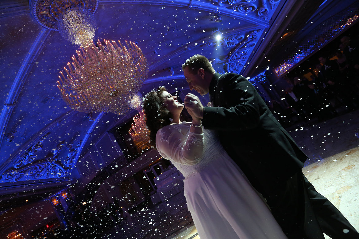 snow during first dance at wedding
