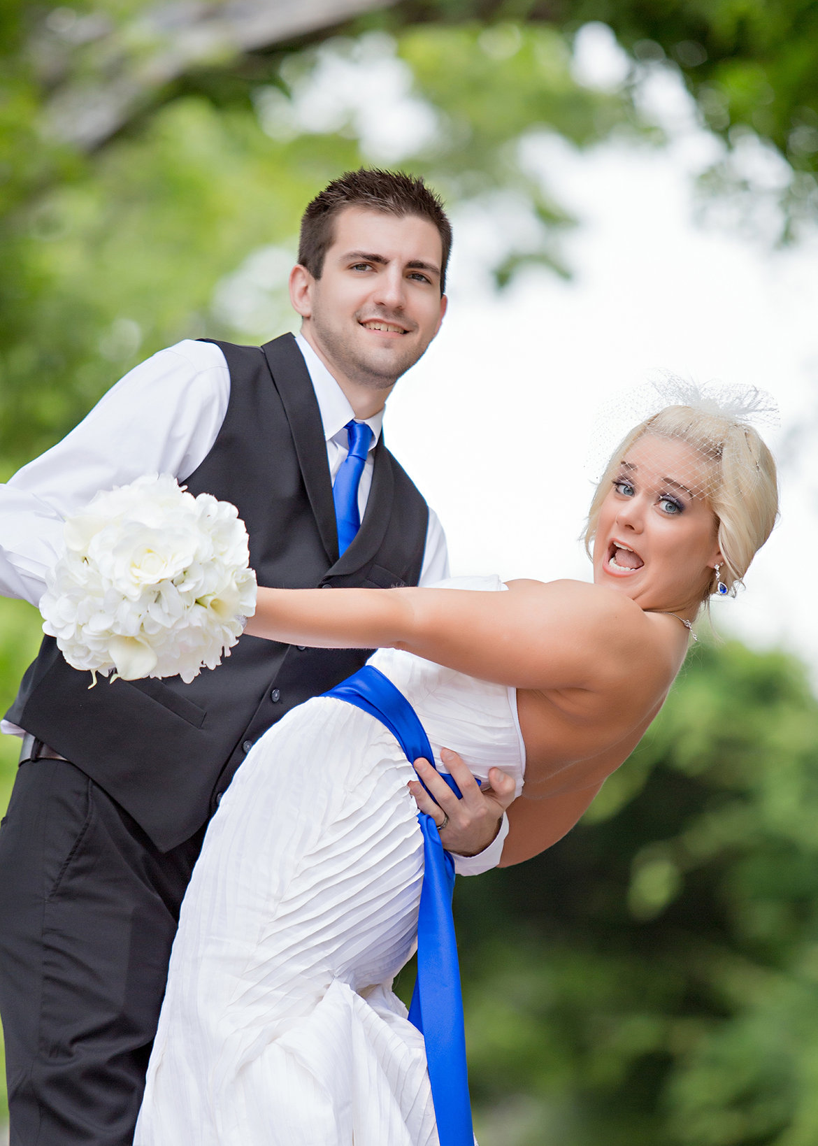 bride and groom making funny face