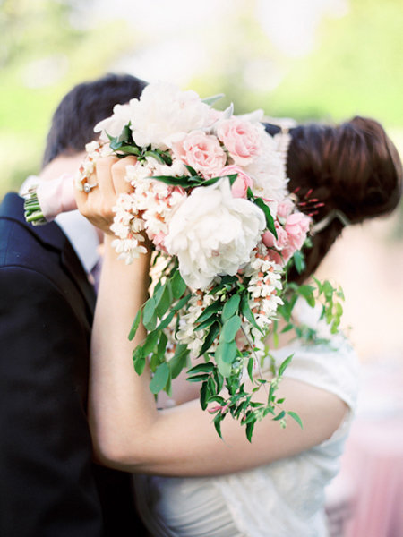 newlyweds holding bouquet