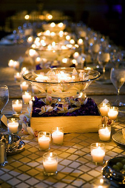 15 fun ways to light up your wedding bridalguide 1 cluster candles into groups after the sun sets wed love to have the tables glow too these centerpieces are compromised almost entirely out of solutioingenieria Choice Image