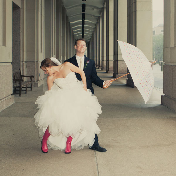 bride and groom wearing rainboots