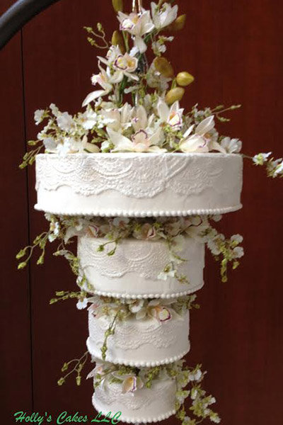 Trend we love gravity defying wedding cakes bridalguide cake design hollys cakes photos by hollys cakes left and right and lifesong photographic art middle mozeypictures Image collections