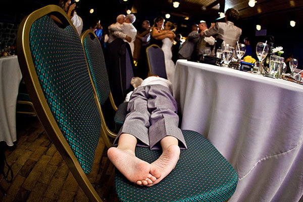 kid sleeping across chairs