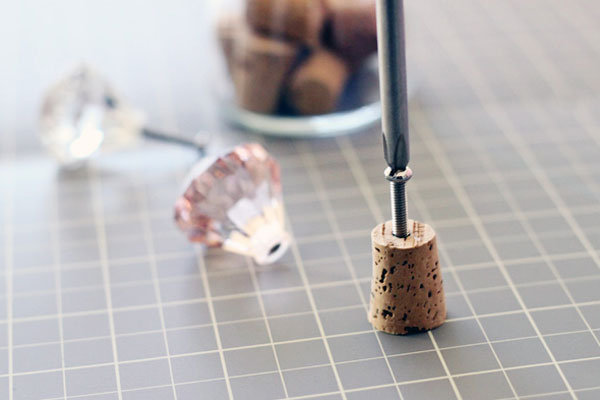 drilling a hole into a bottle cork
