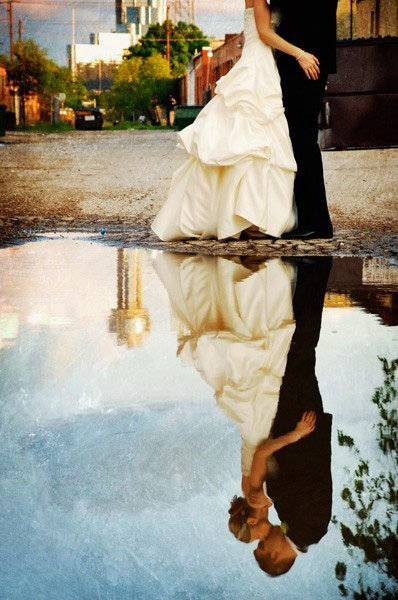 couple reflection in water