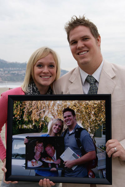 couple holding photo frame