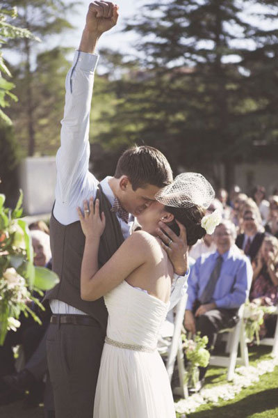 groom pumping fist into air