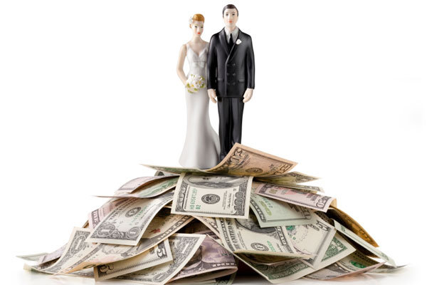 cake topper on top of a pile of money