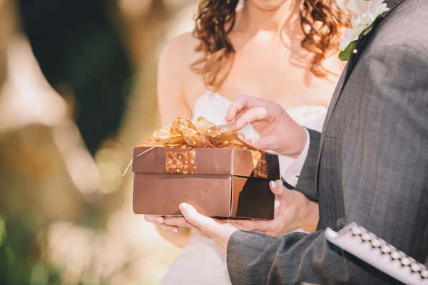 bride and groom with gift