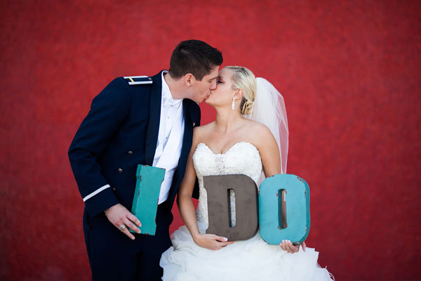 bride and groom with i do sign