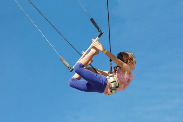 girl swinging on trapeze