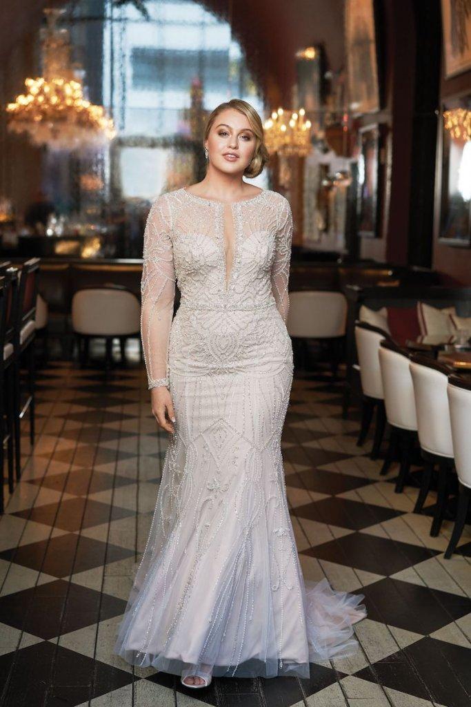 b26c8b46d0a 8 Sexy Wedding Gowns for Curvy Brides BridalGuide