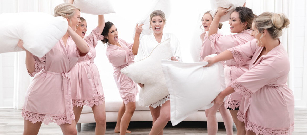 Bride and bridesmaids pillow fight