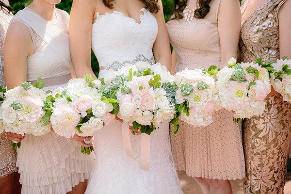 Women in wedding holding flowers