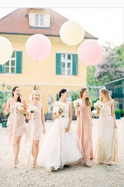 bride and bridesmaids with balloons