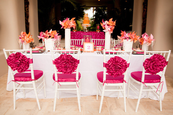 25 gorgeous ways to decorate your chairs bridalguide for Decorating chairs for wedding reception