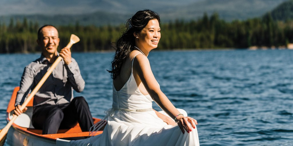 bride and groom on the water