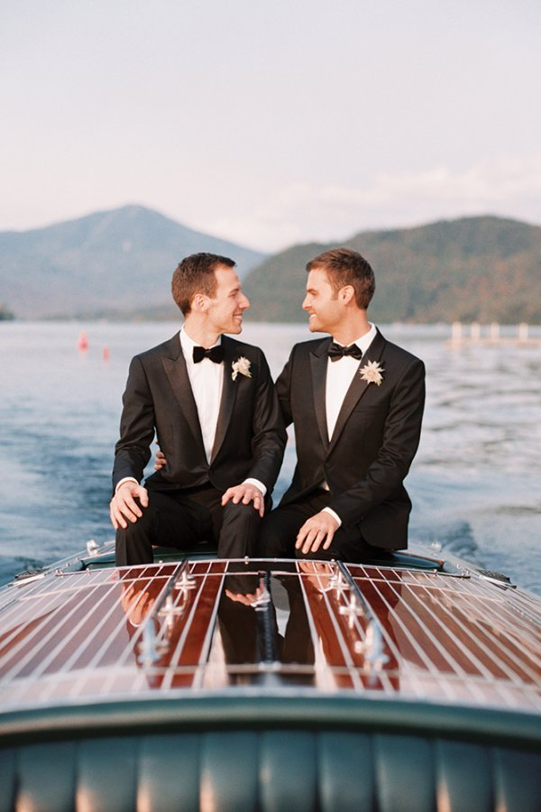Grooms on a boat in Lake Placid NY