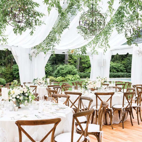 Outdoor wedding reception under tent