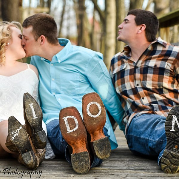 bride and groom engagement photo with best man