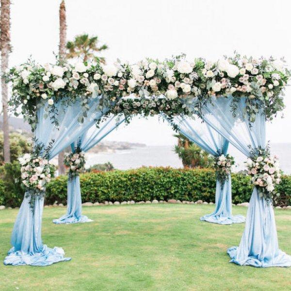 blue chiffon and blush floral wedding canopy