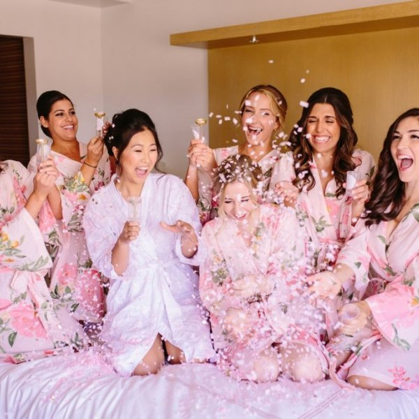 bridesmaids getting ready photo with confetti