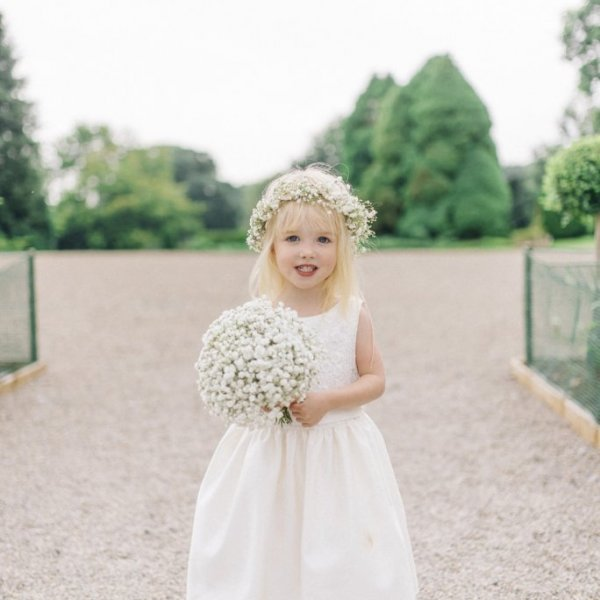 flower girl with baby's breath crown and bouquet