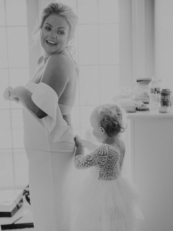 bride and flower girl getting ready for wedding