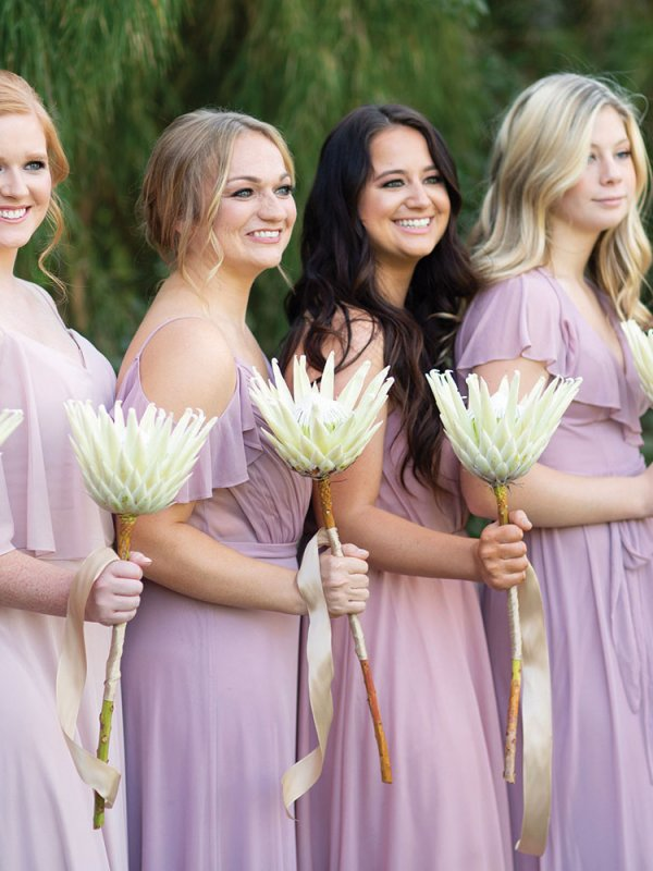 bridesmaids with king protea bouquets