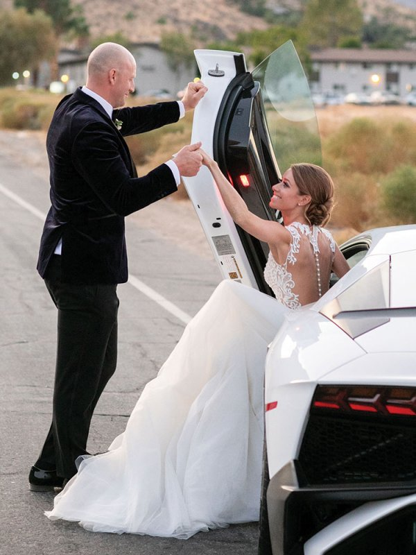 bride and groom in lamborghini