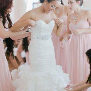 trying on wedding dress