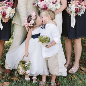 This Adorable Flower Girl Stole the Show at Her Mom's Wedding.