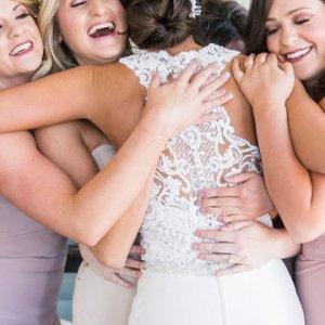 Group hug with bridesmaids