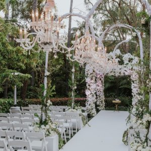 Chandeliers over wedding ceremony aisle