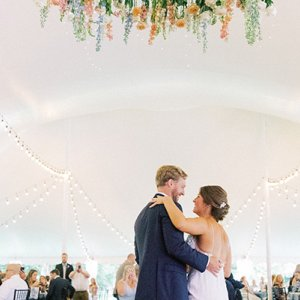 Floral chandelier wedding reception decor