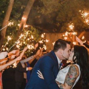 Outdoor chandelier wedding sendoff with sparklers
