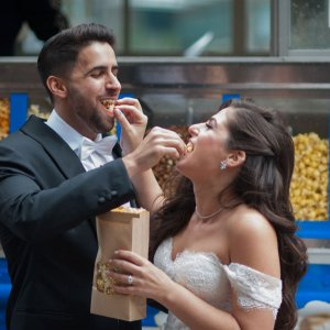 Couple Feeding Each Other Popcorn