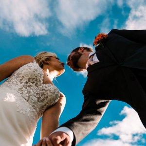 low angle bride and groom wedding photo